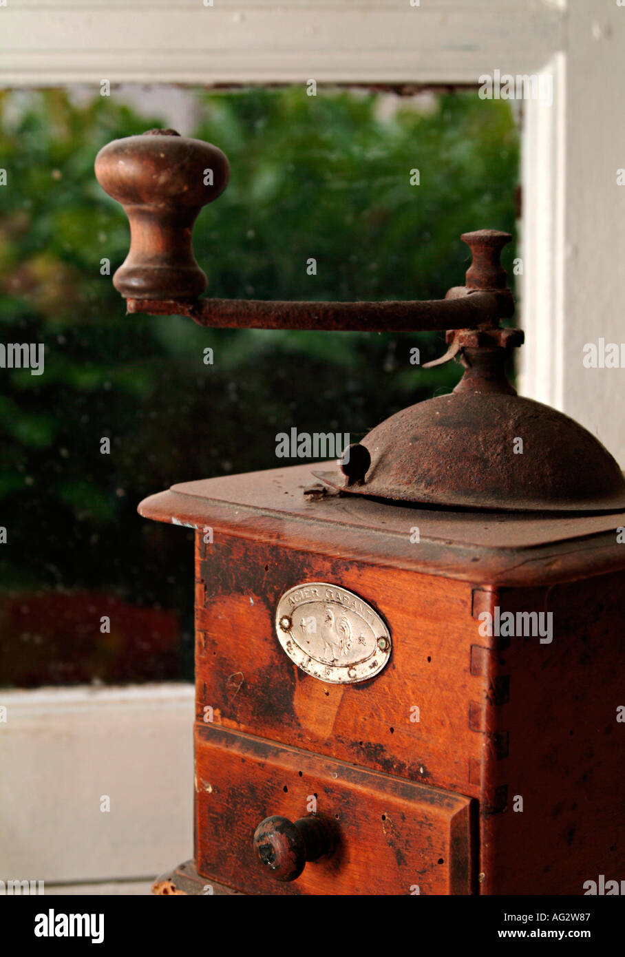 old nostalgic coffee mill grinder on window sill - Stock Image