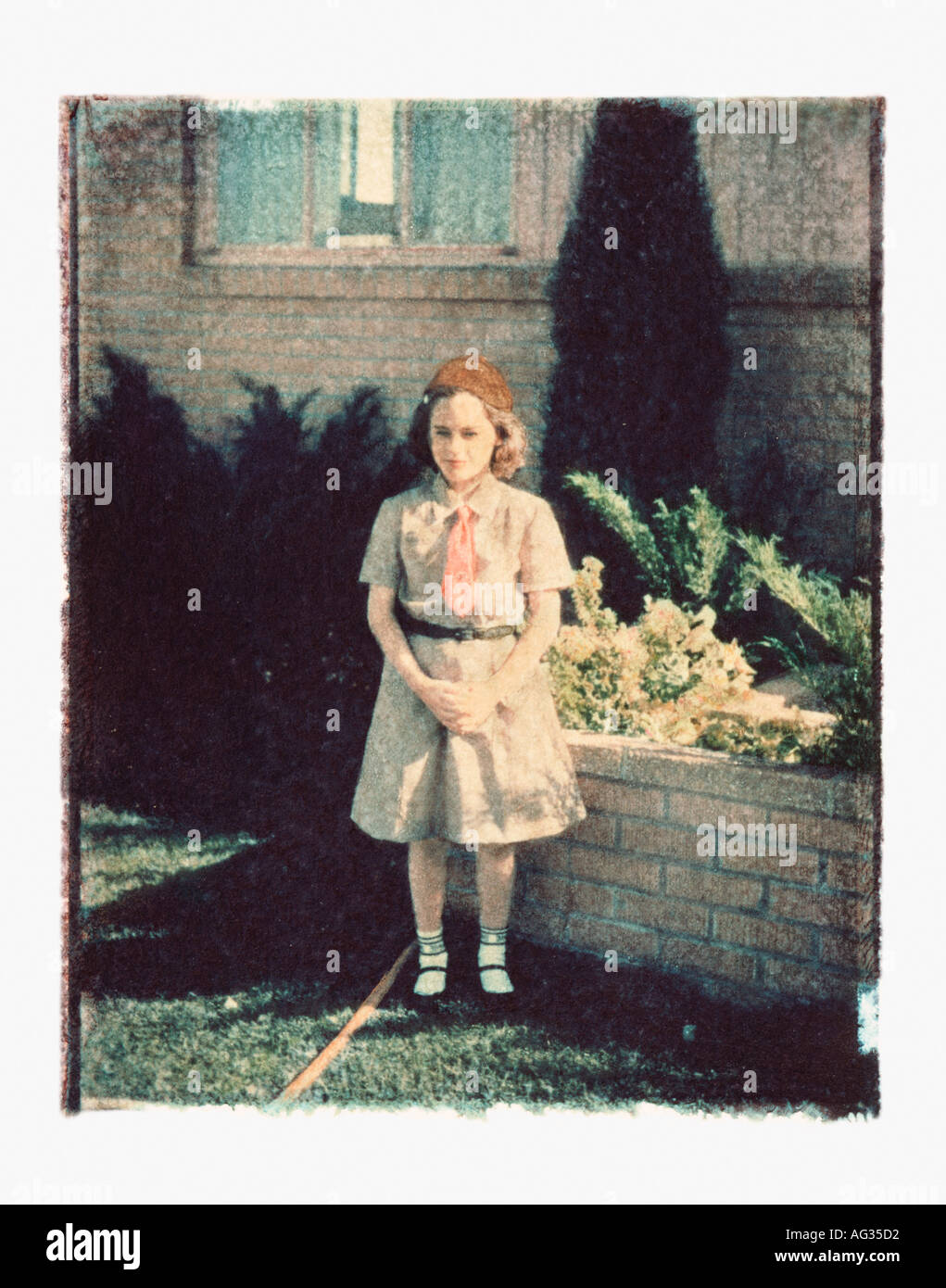 Polaroid transfer portrait of girl in Brownie outfit circa 1960s Stock Photo