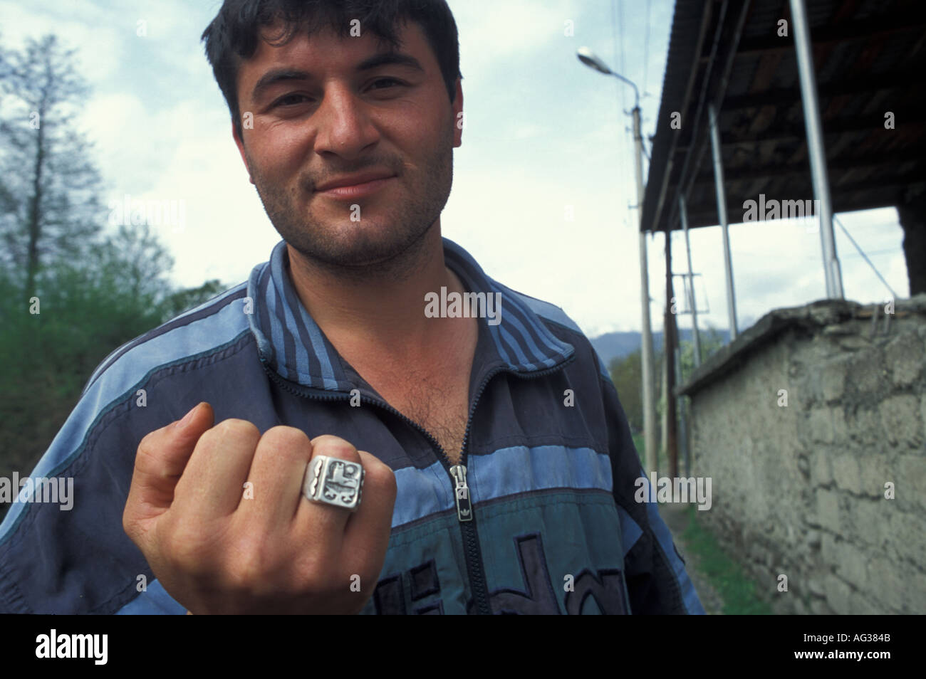 Chechen refugee showing his ring Pankisi gorge Georgia - Stock Image