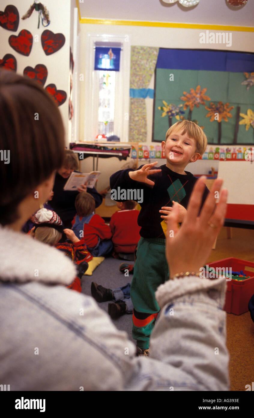 Parent saying goodbye to child at nursery - Stock Image