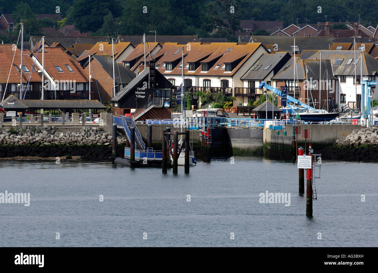 the entrance and lock to hythe marina village southampton water solent hampshire hythe uk new forest - Stock Image