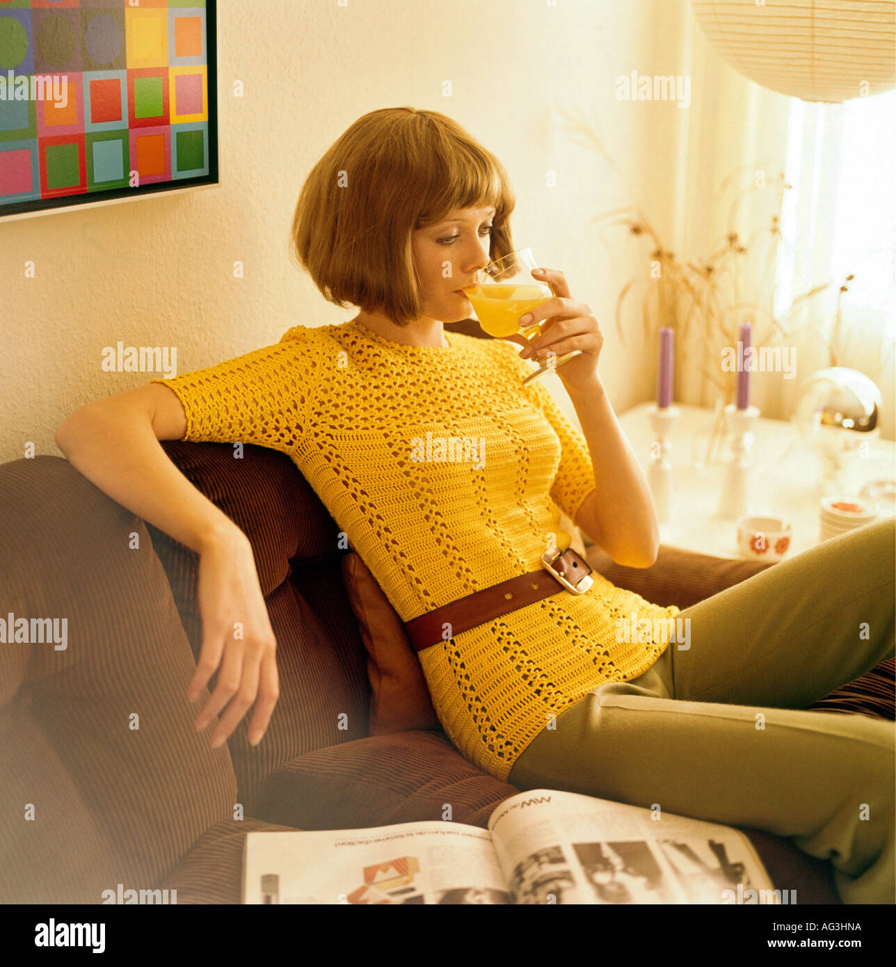 People, Women, 1960s, Woman Sitting On A Cord Sofa And Drinking Orange  Juice, Half Length, Fashion, 60s, Historic, Historical, P