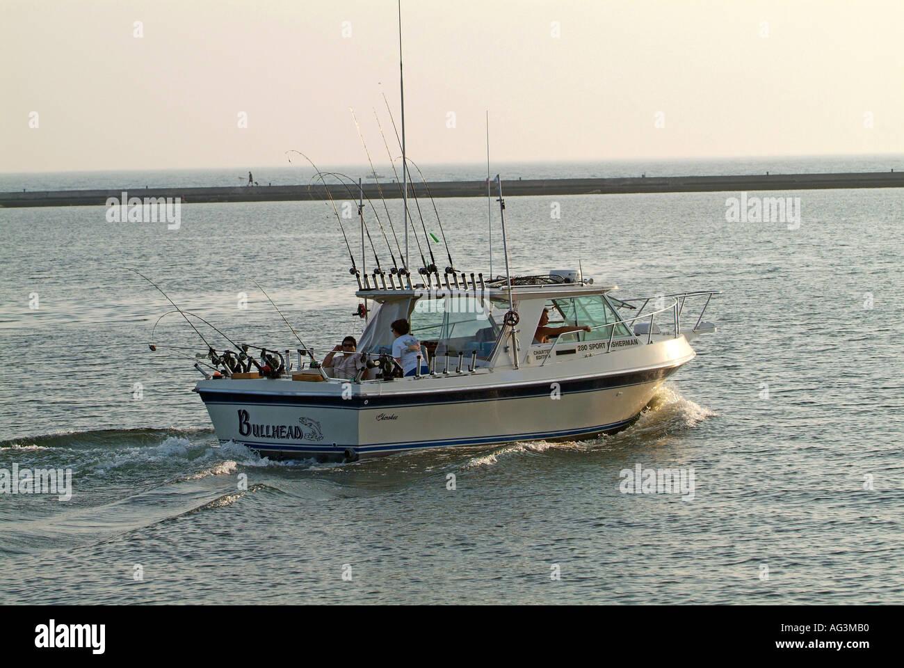 Recreational boating fishing on Lake Michigan at Manistee Michigan Stock Photo