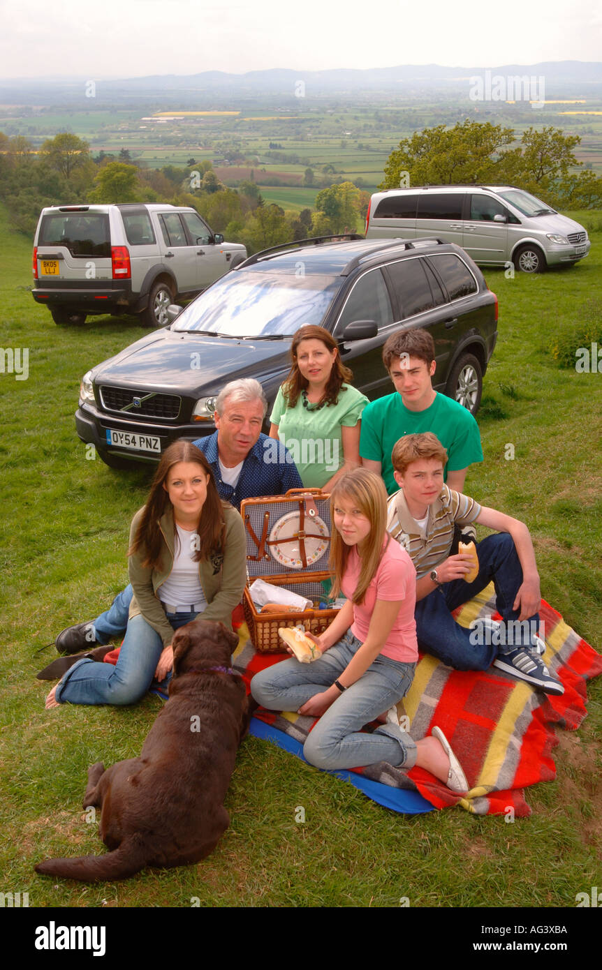 A FAMILY WITH TEENAGE CHILDREN ON A PICNIC UK - Stock Image