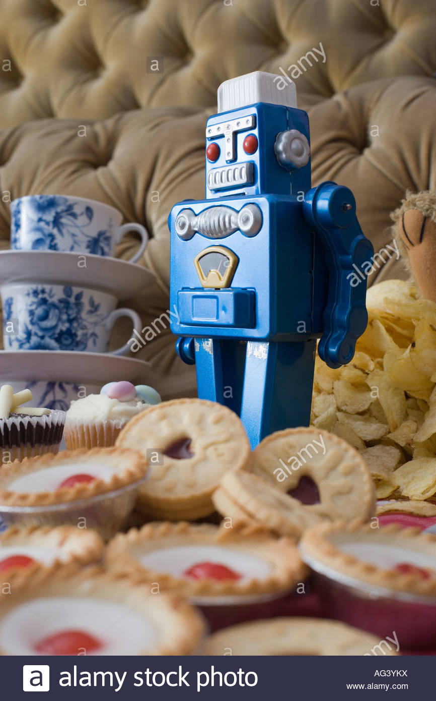 Robot toy with cakes and biscuits Stock Photo
