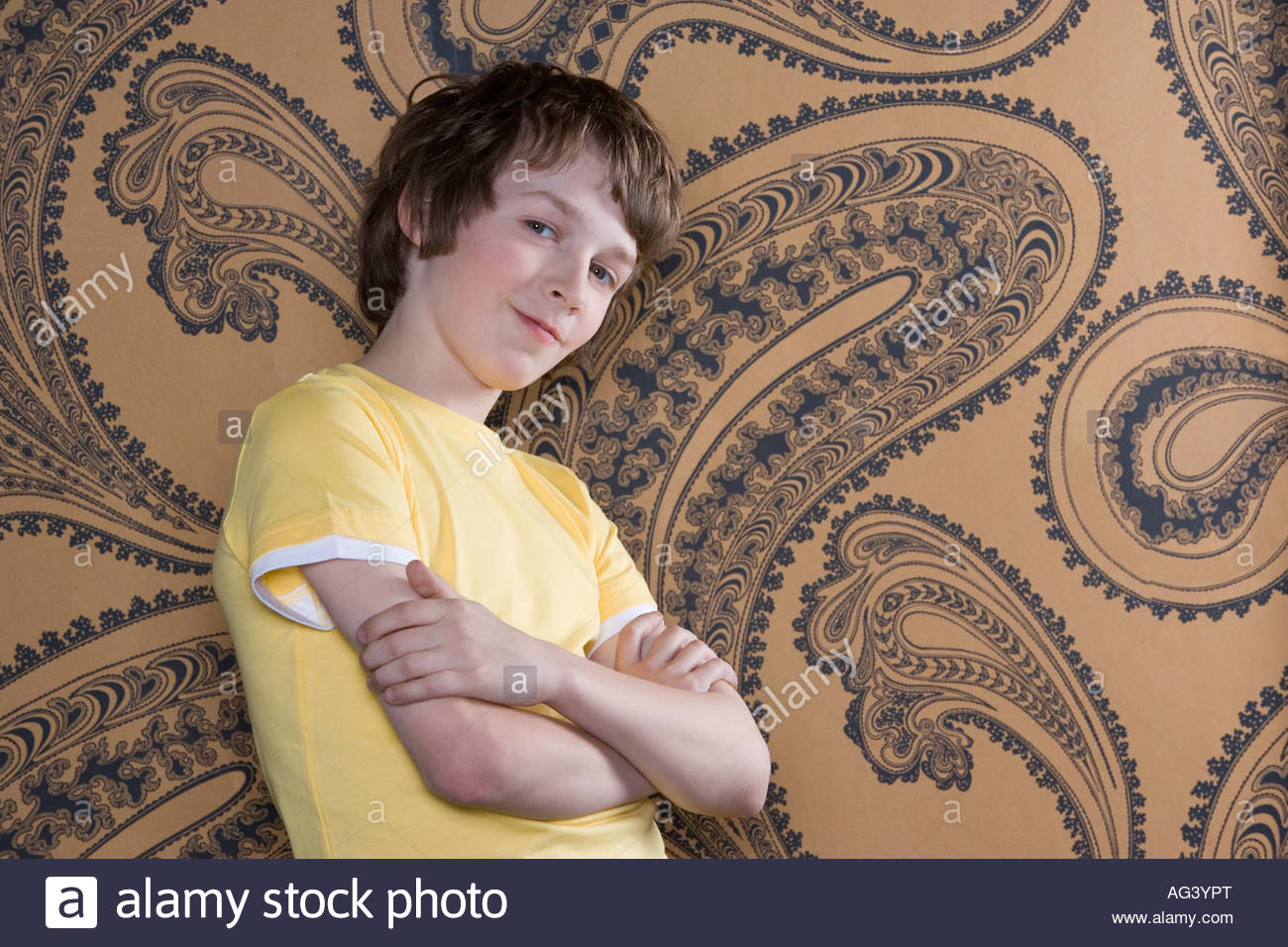 Boy with crossed arms - Stock Image