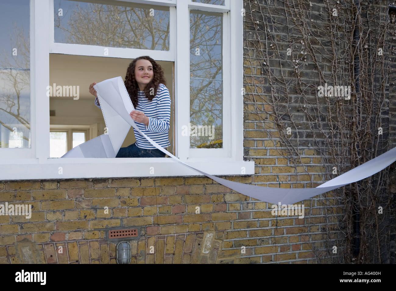 Teenage girl being mischievous - Stock Image