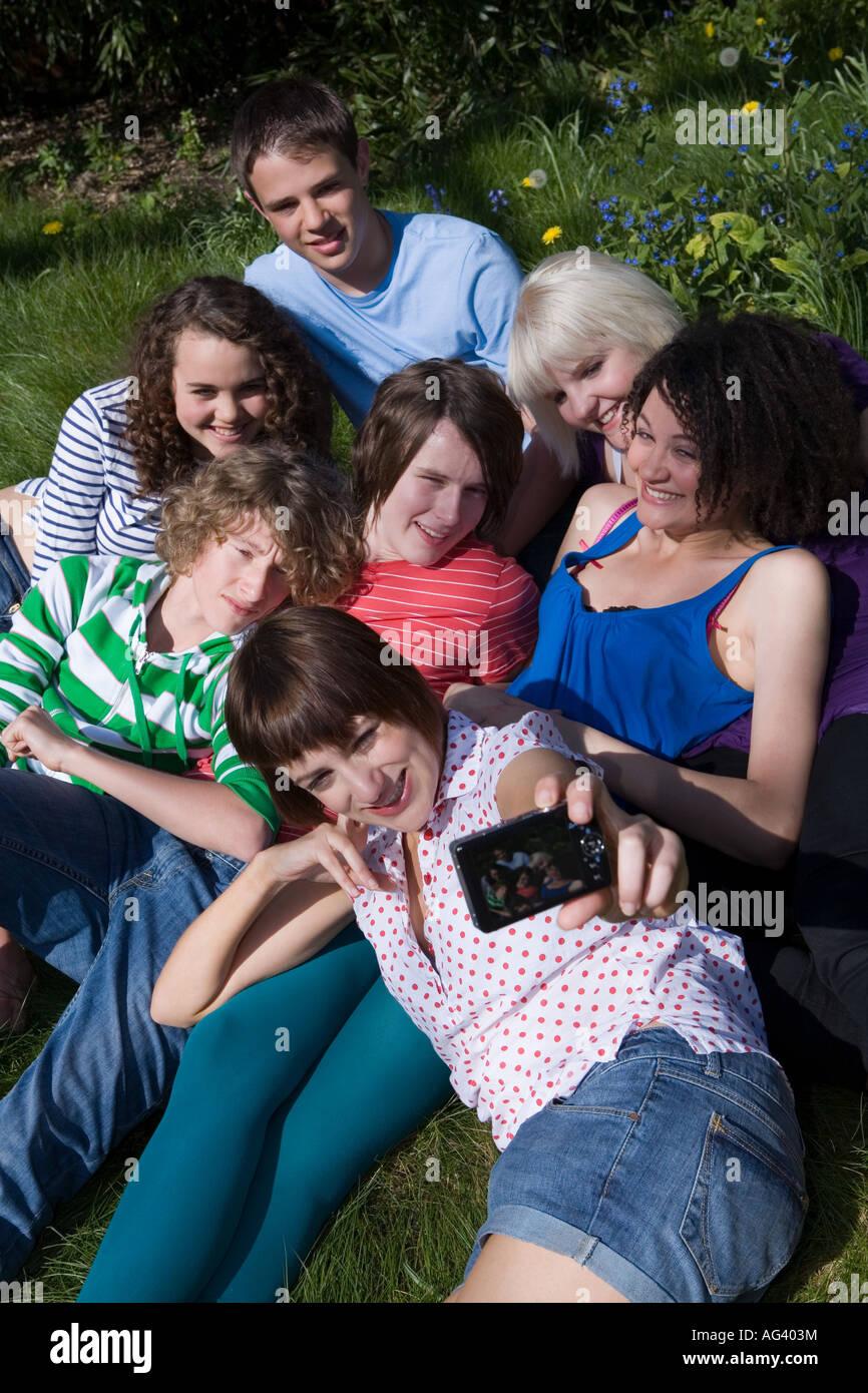 Friends having photo taken - Stock Image