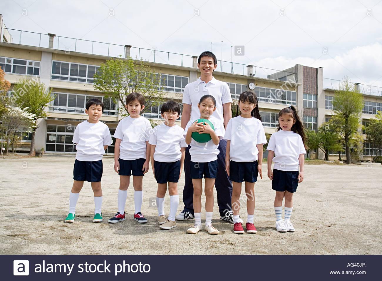 Portrait of school children and their teacher - Stock Image