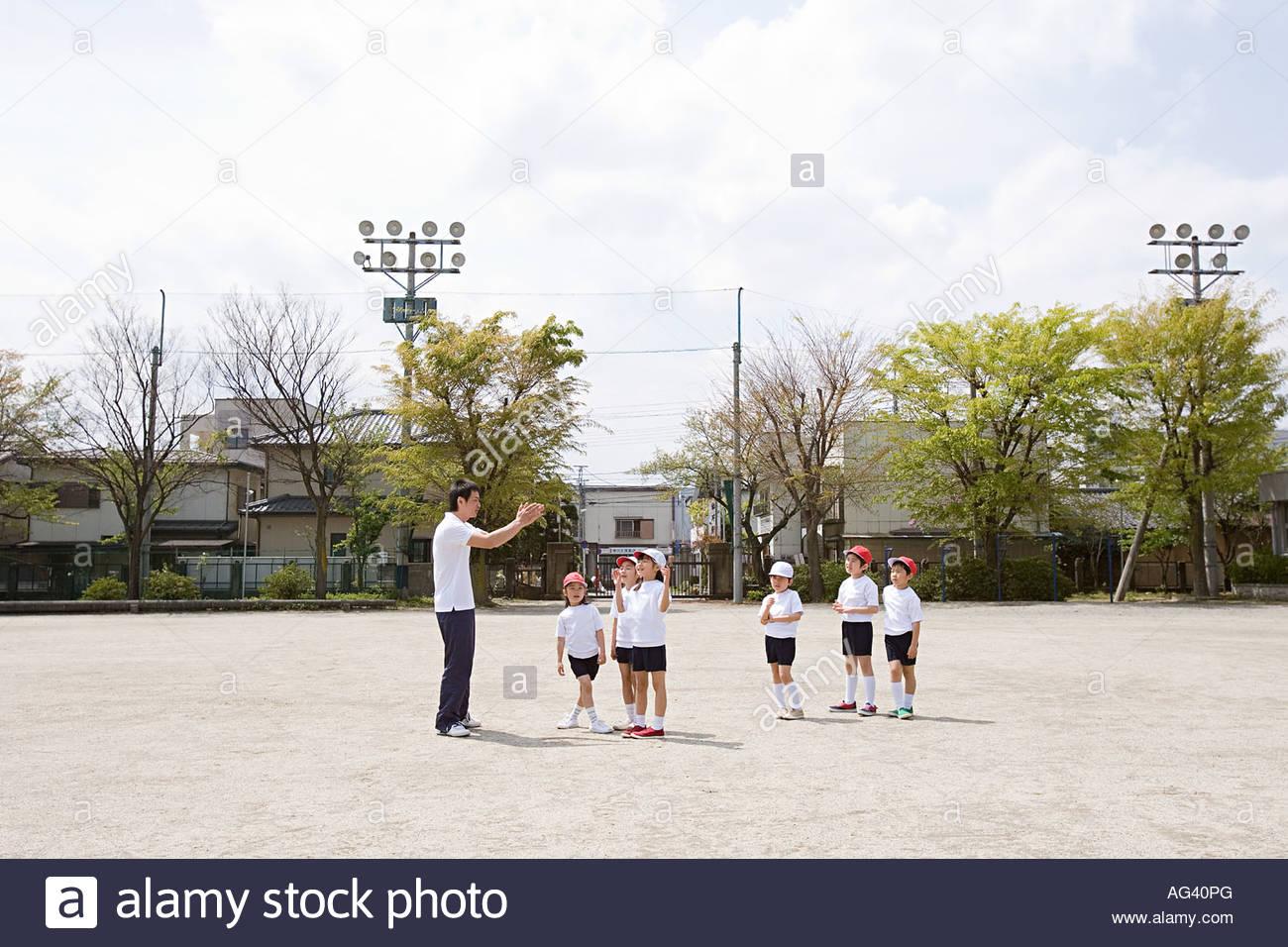 Teacher and school children - Stock Image