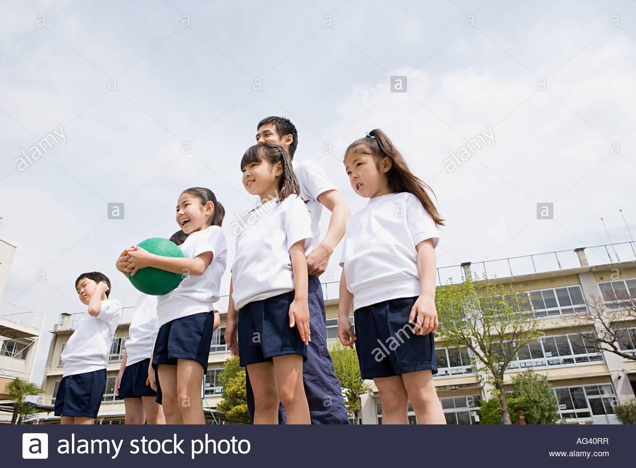 A teacher and school children - Stock Image