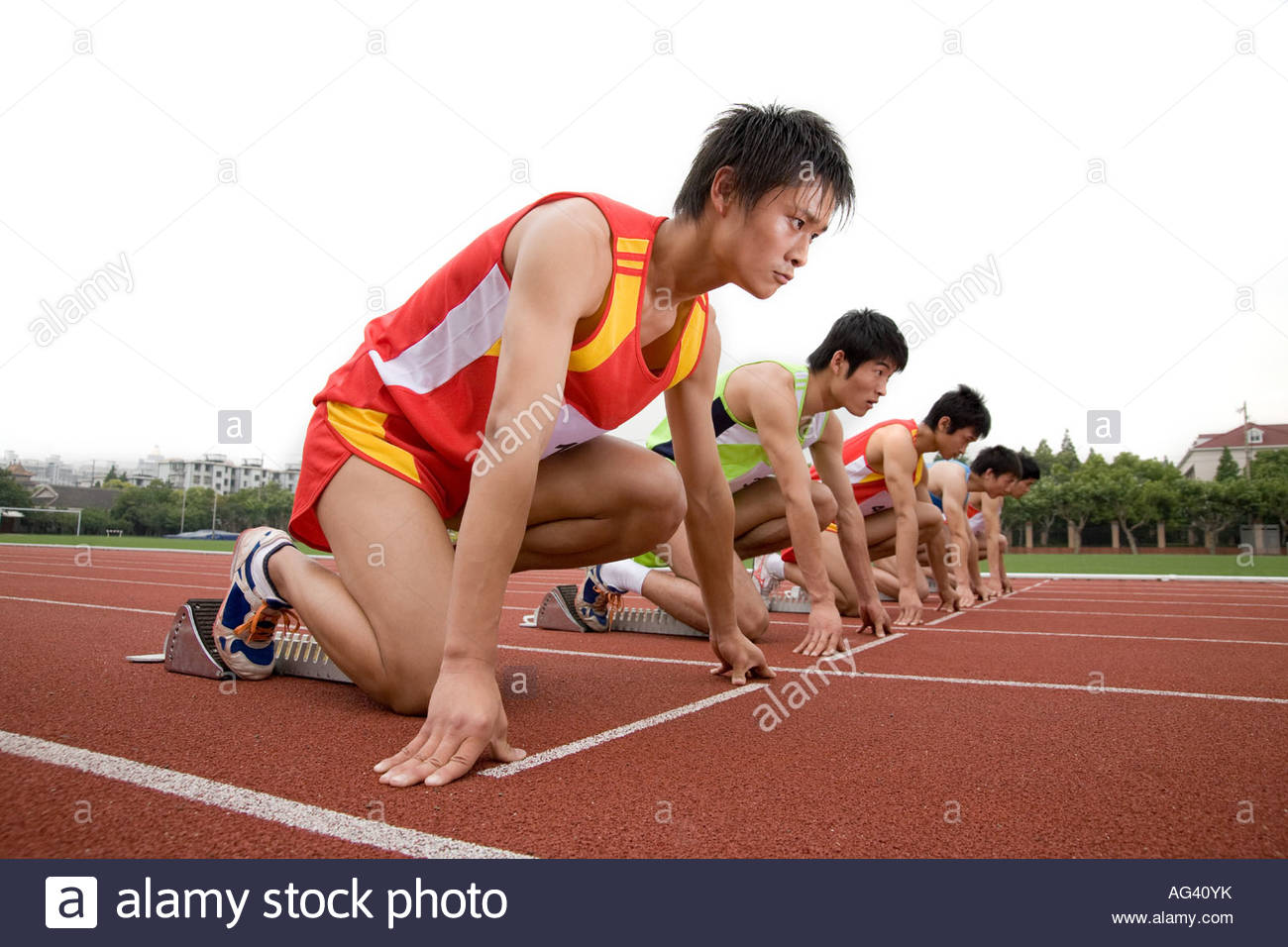 Runners on starting line - Stock Image