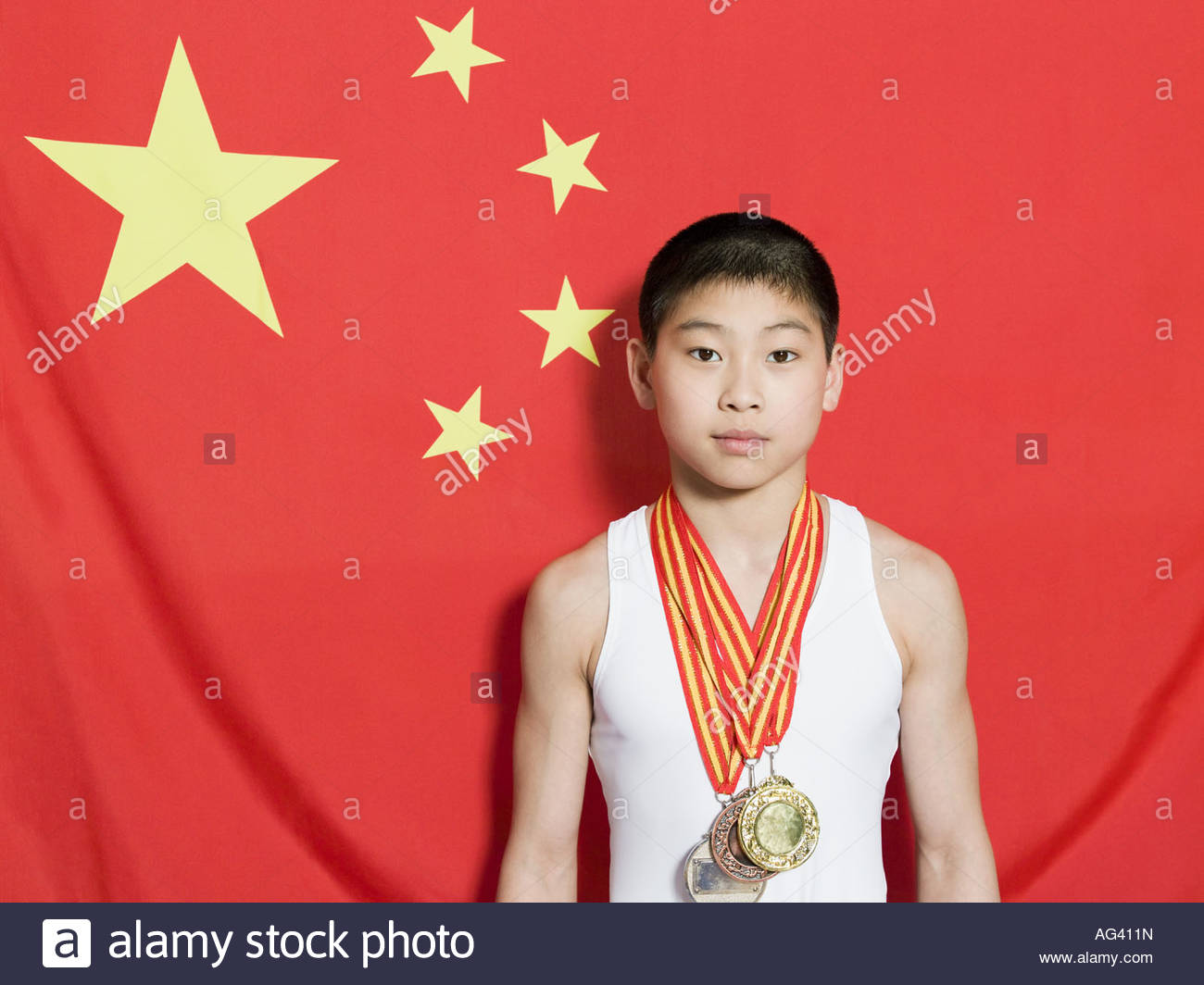 Boy with chinese flag and medals - Stock Image