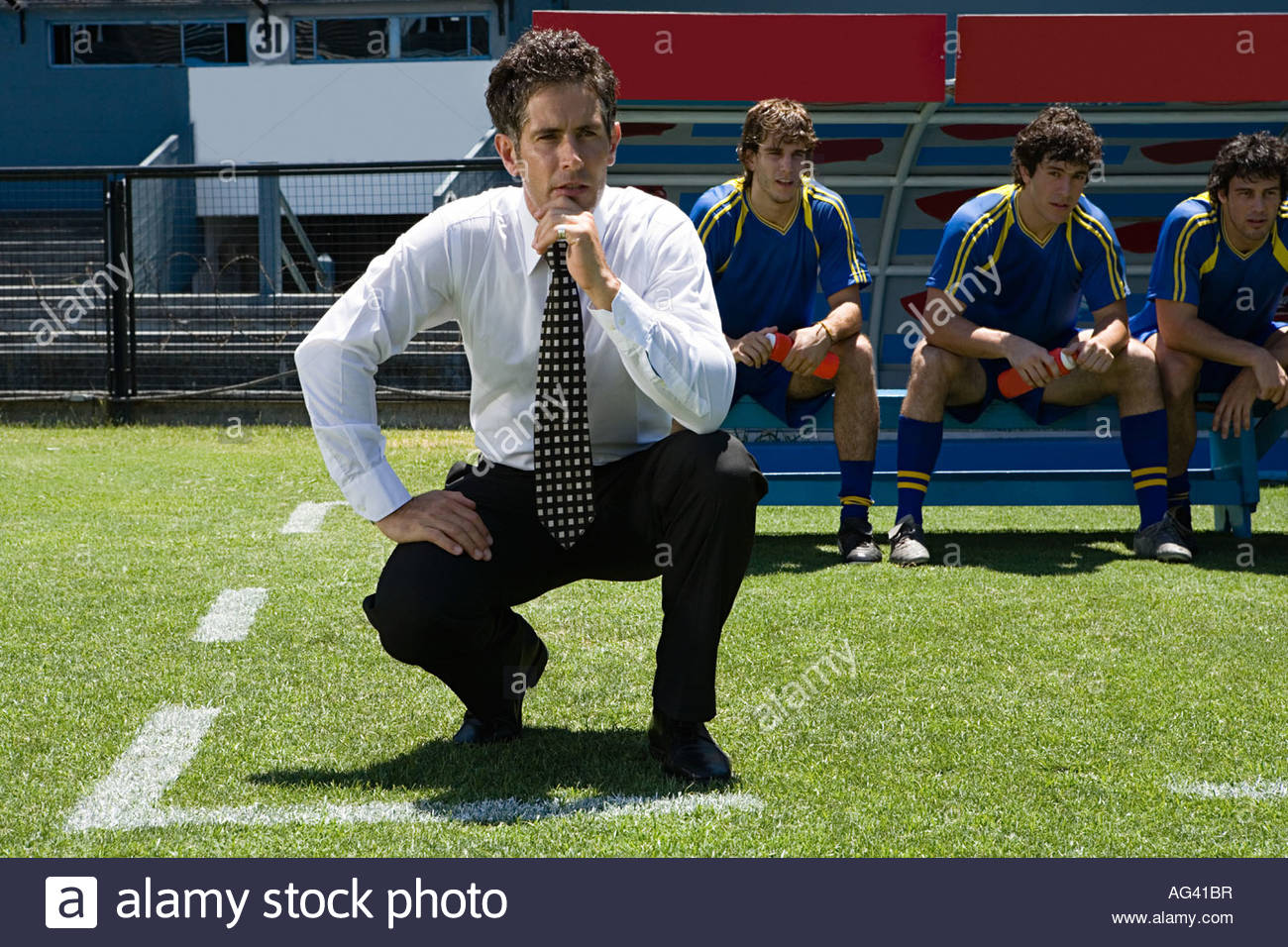 Football manager watching football match Stock Photo