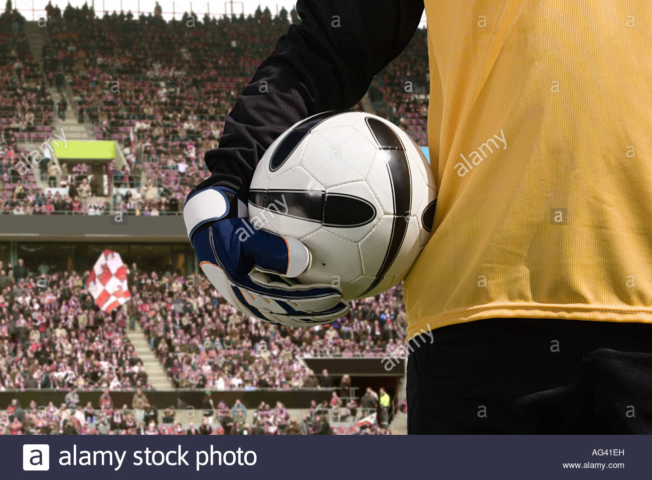 Goalkeeper holding a football - Stock Image