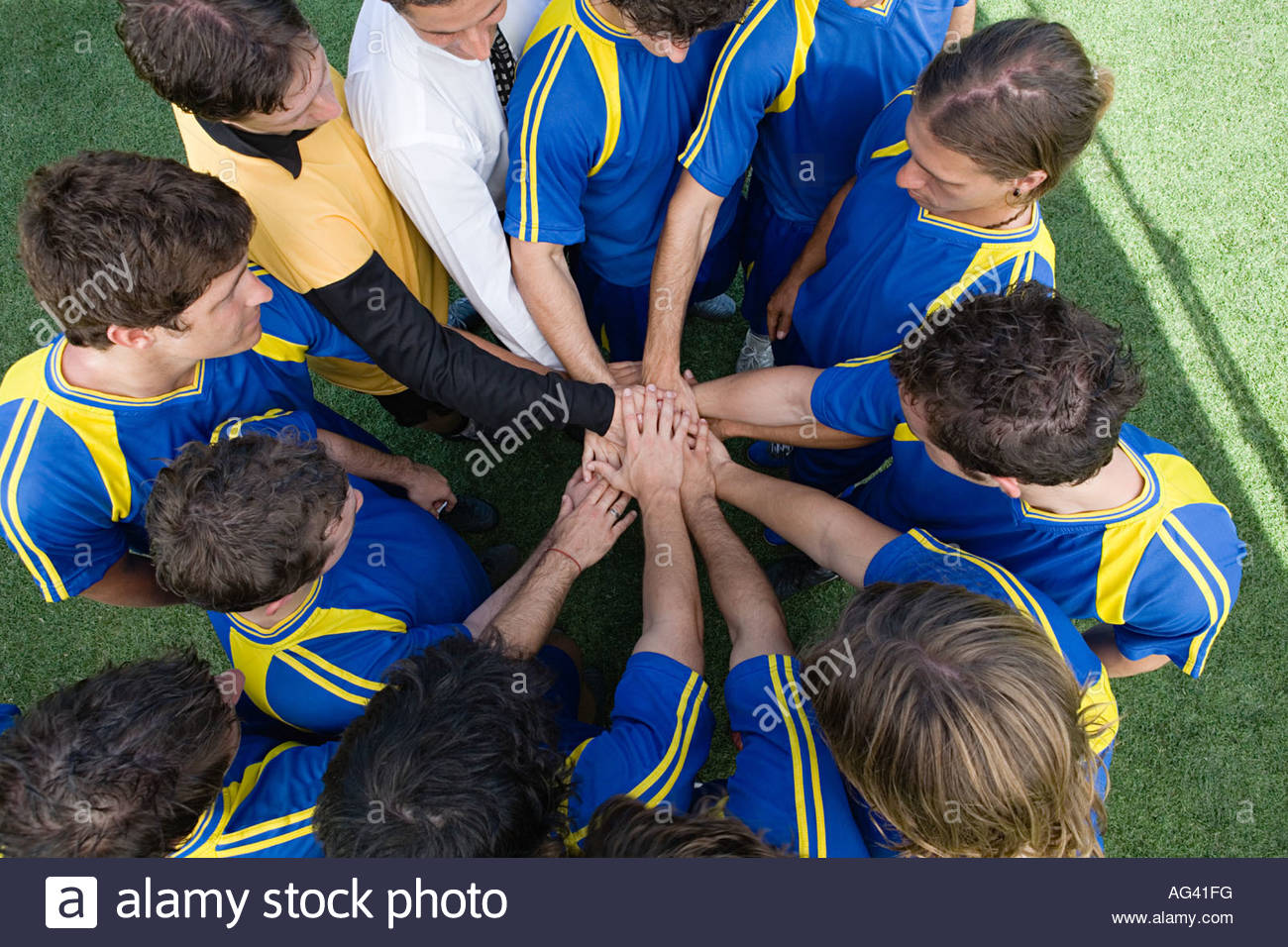 Footballers bonding - Stock Image