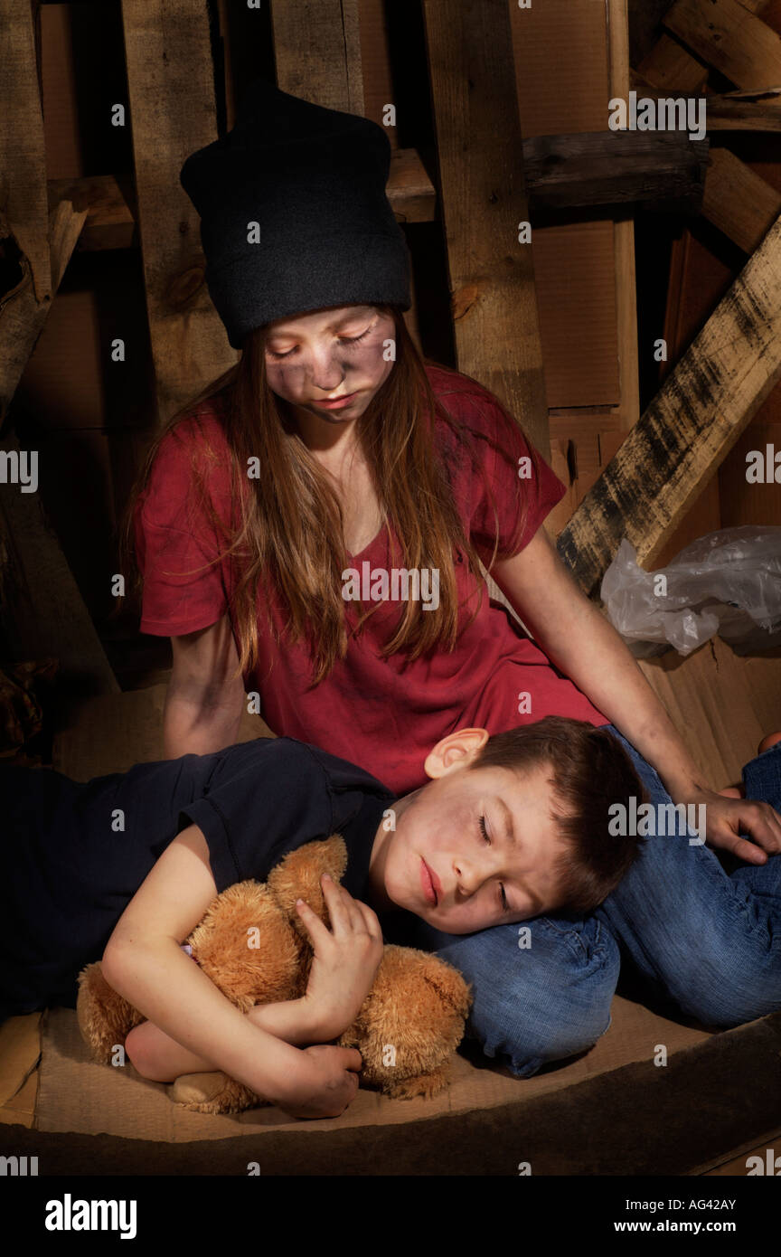 Impoverished boy and girl Stock Photo