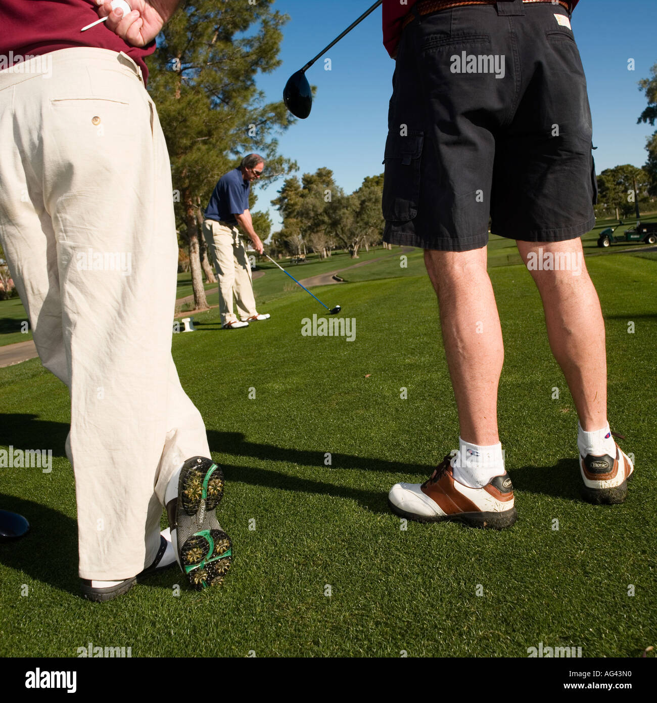 golf waiting to t off at the fairway - Stock Image
