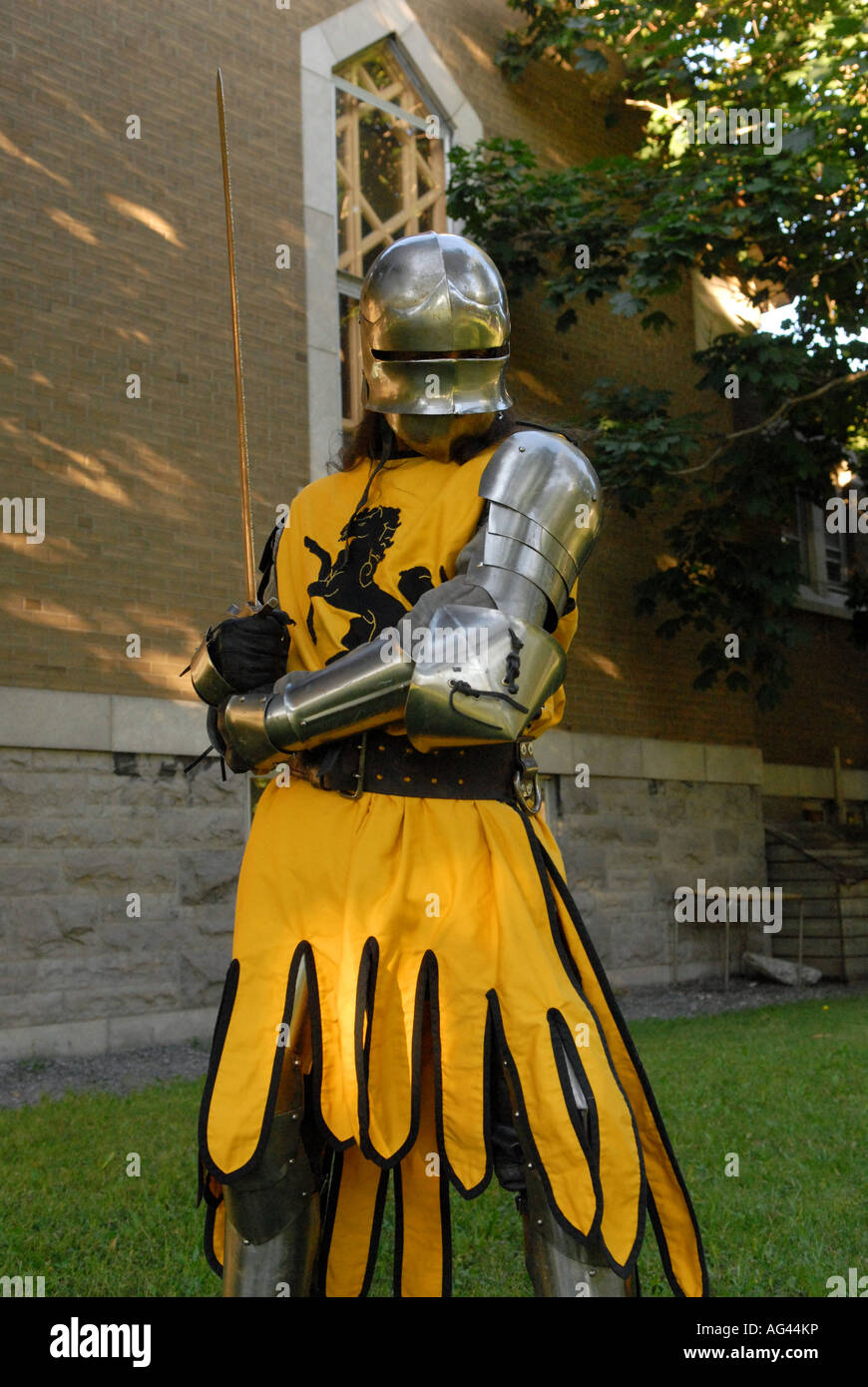 Medieval knight holding a sword - Stock Image