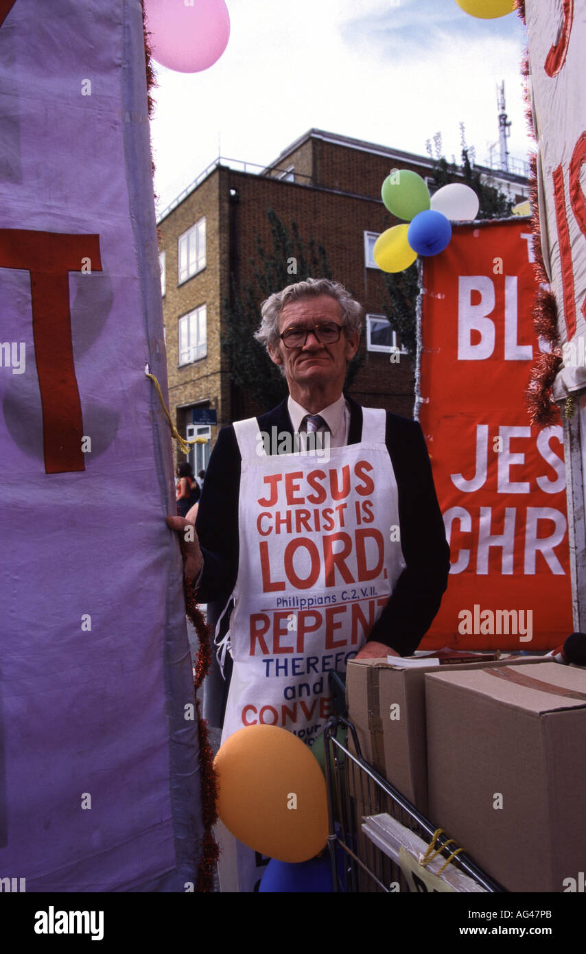 A religious preacher makes his feelings known in the Notting Hill Carnival, London, UK. - Stock Image