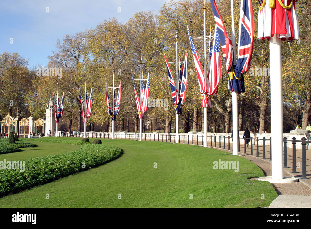 Flags of the world around the green outside Buckingham palace - Stock Image