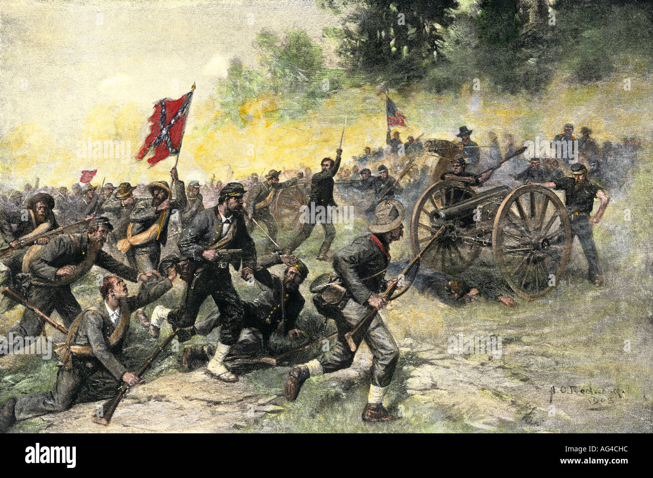 Confederate assault on Little Round Top held by the 20th Maine Regiment in the Battle of Gettysburg 1863. Hand-colored halftone of an illustration - Stock Image