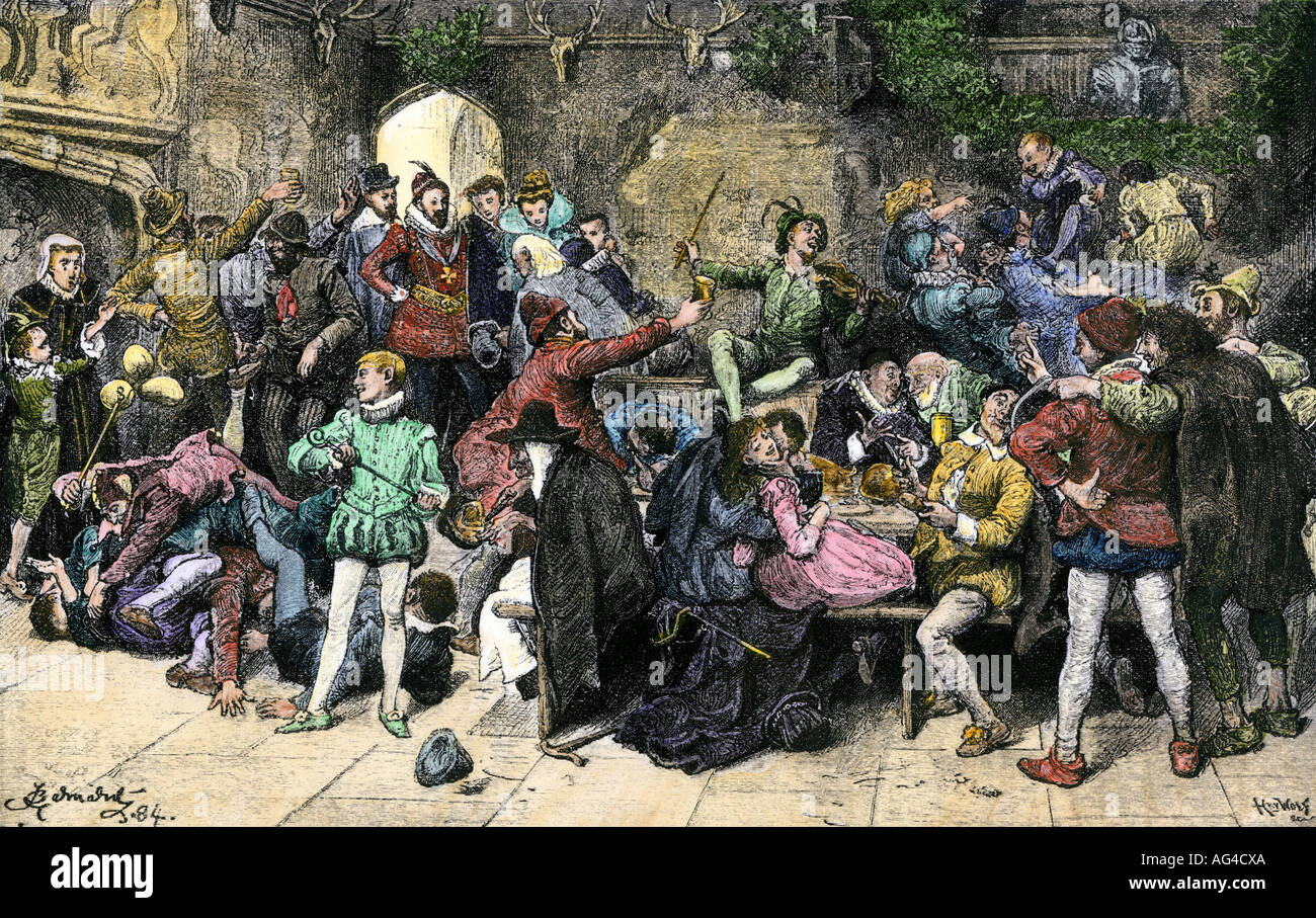 Christmas merriment in an old English manor 1500s. Hand-colored woodcut - Stock Image