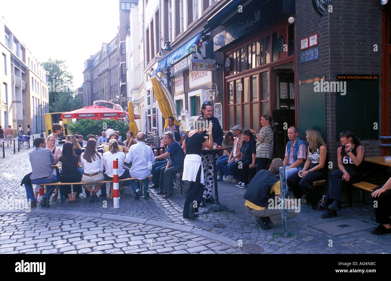 Germany North Rhine Westphalia Dusseldorf People drinking beer outside a  beer hall in the Altstadt Old Town