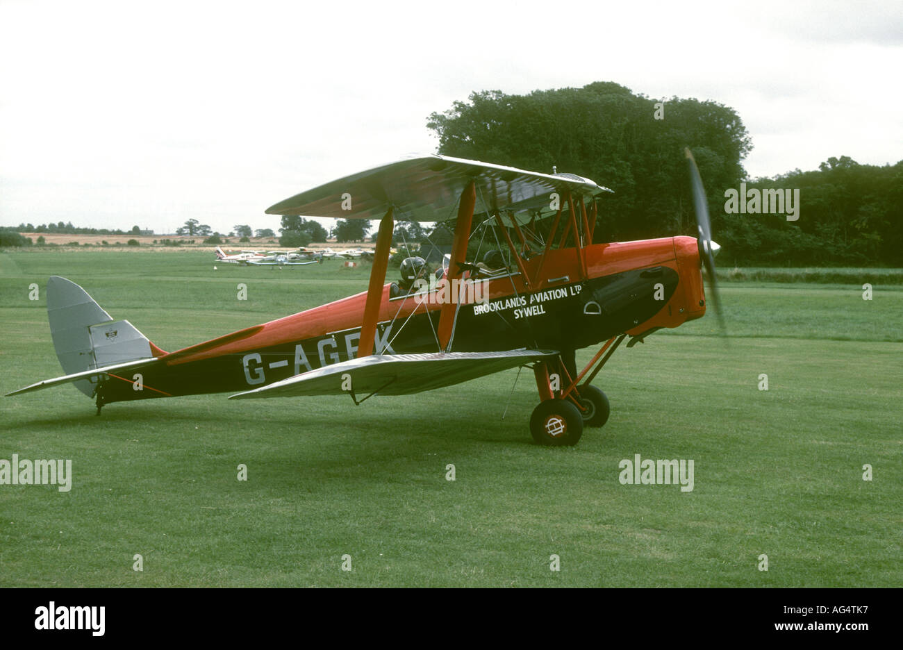De Havilland DH82A Tiger Moth G-AGPK of Brooklands Aviation, Sywell taxiing out for takeoff at Old Warden Airfield - Stock Image
