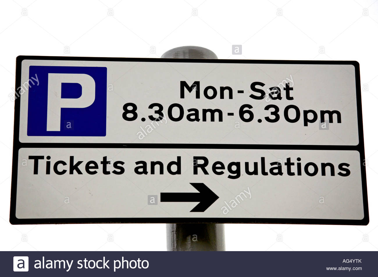 Parking signpost tickets and regulations - Stock Image