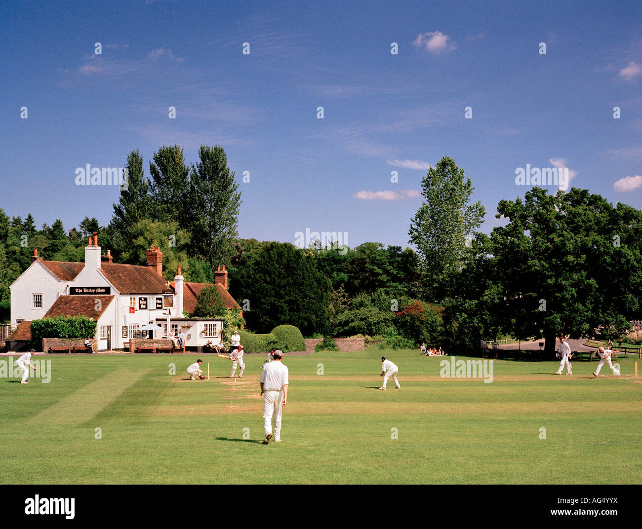 Game of village cricket Tilford Green, Surrey, England, UK. Stock Photo