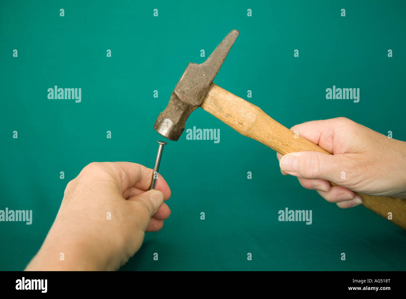 STUDIO Hitting the nail on the head with a hammer Stock Photo ...