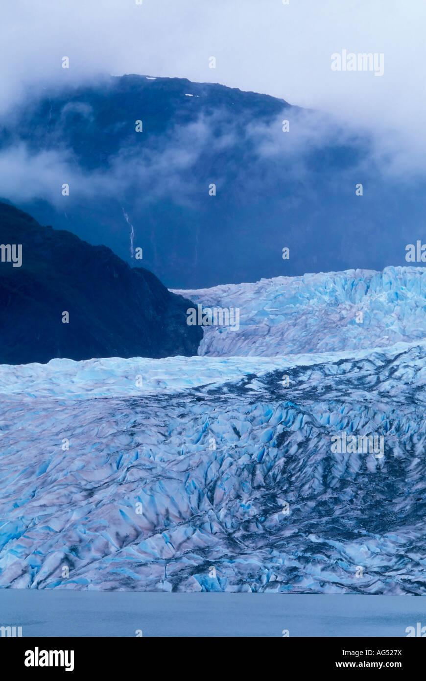 Mendenhall Glacier, edge of lake, distant mountain - Stock Image