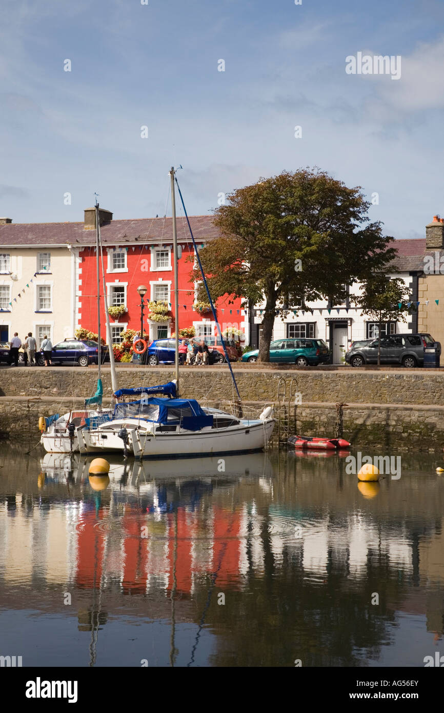 Aberaeron, Ceredigion, Wales, UK. Harbour waterfront houses with moored boats - Stock Image