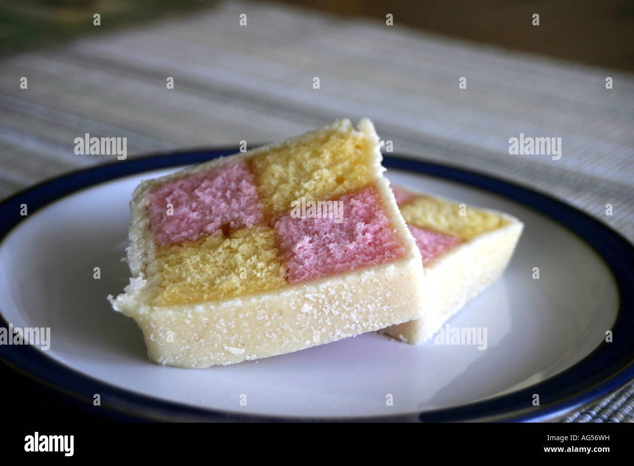 Battenburg cake waiting to be eaten. - Stock Image