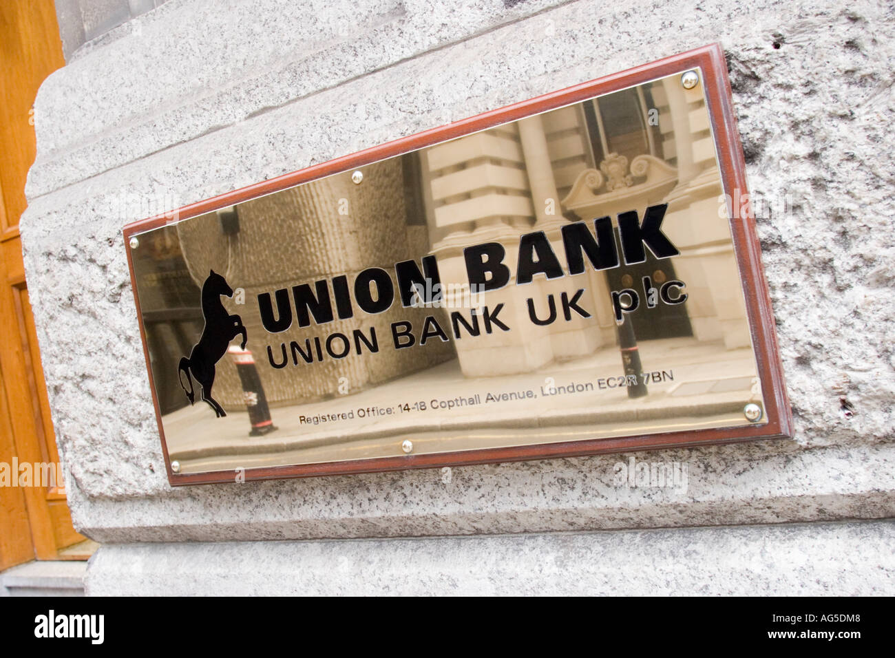 Union Bank UK plc brass plate outside offices in Copthall Avenue in the City of London GB UK - Stock Image