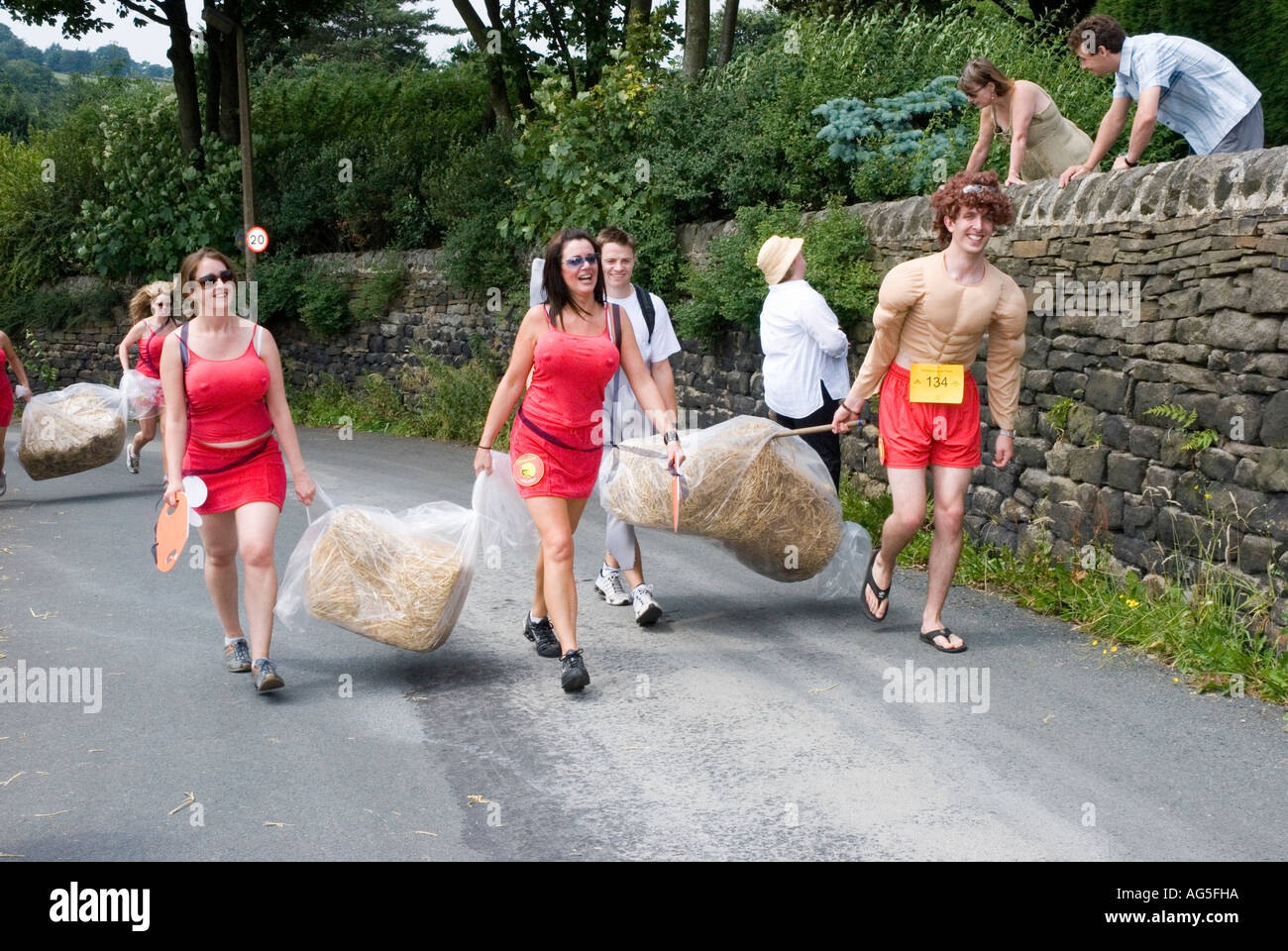 Runners caveman fancy dress for the Oxenhope Straw Race - Stock Image