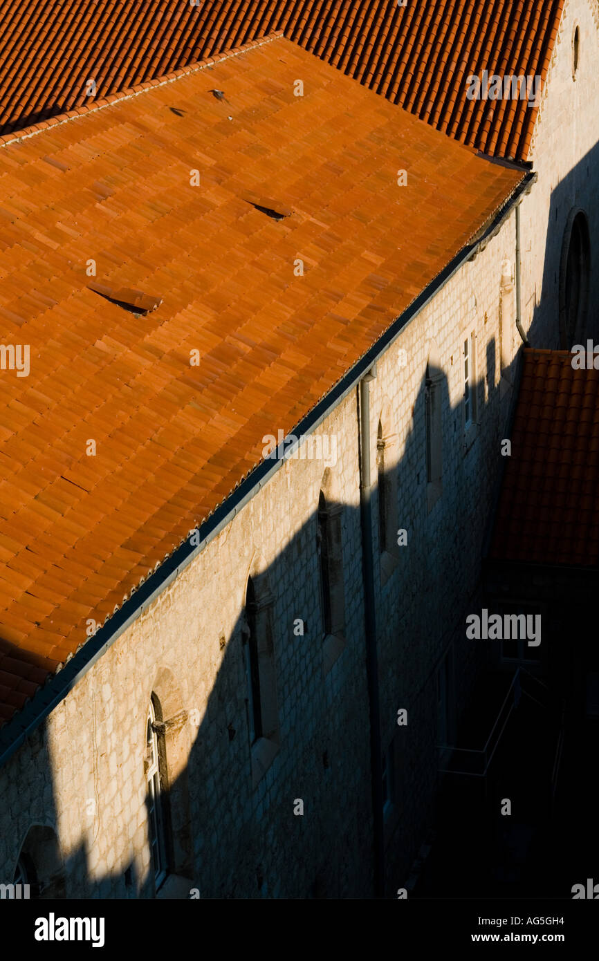 Red tiled rooftop and strong shadow bellow in Dubrovnik in Croatia, Europe - Stock Image