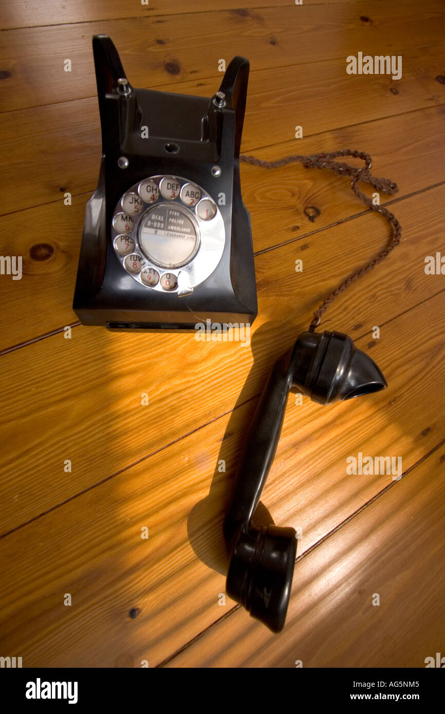 old vintage Bakelite telephone with spin dialer - Stock Image