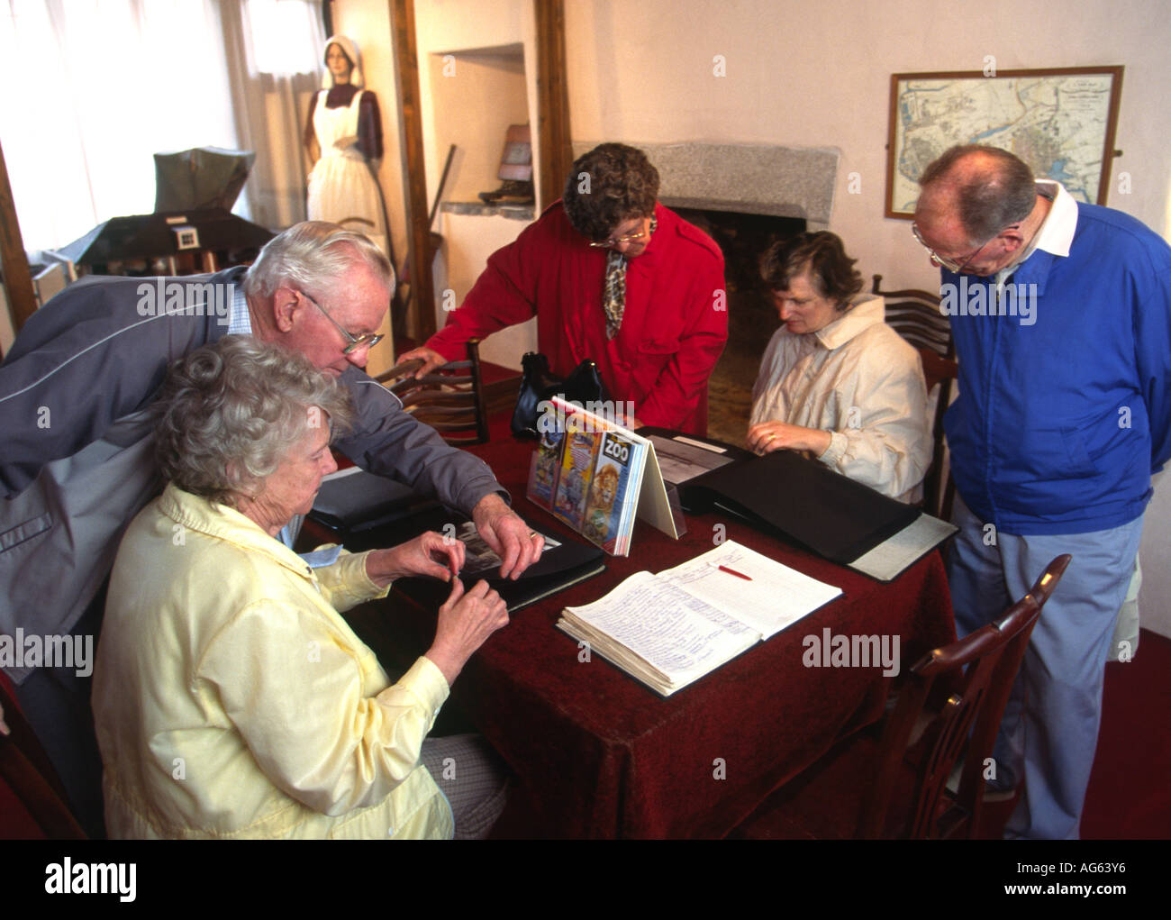 Devon Plymouth Merchants House Museum Beryl Ron Martin looking at local photographs - Stock Image