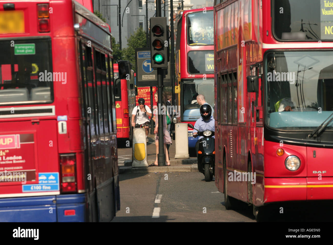 Bus traffic on Oxford Street in London UK - Stock Image