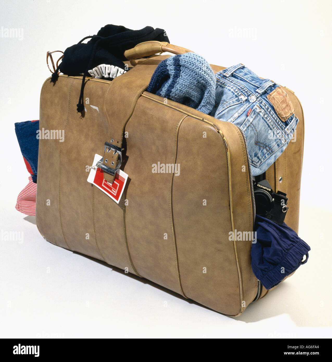 overflowing suitcase - Stock Image