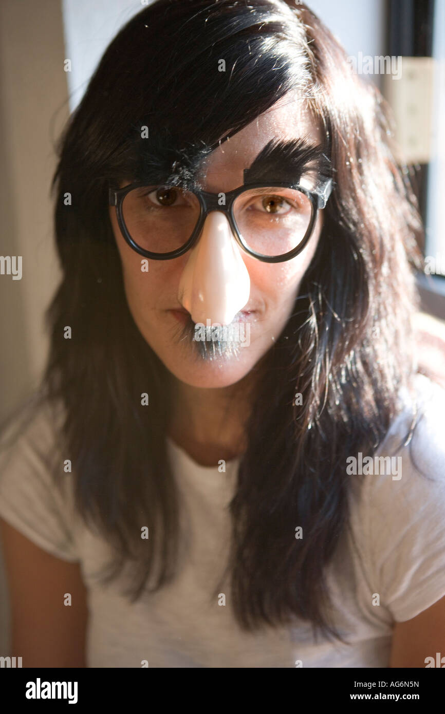 Woman Wearing Silly Groucho Marx Mask With Big Nose Eye Glasses And