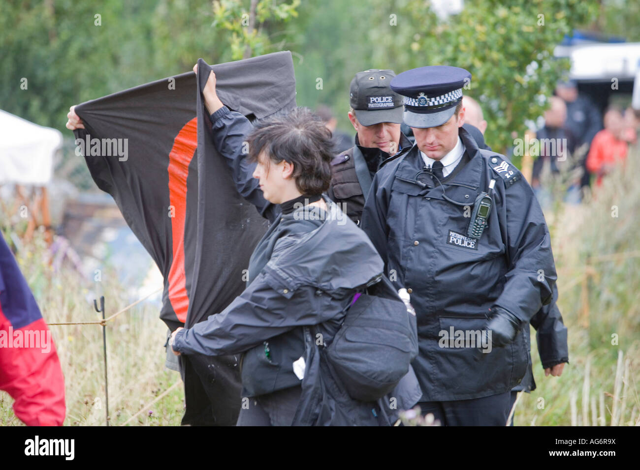 Protestors try to prevent police photographers from photographing protestors at the Climate Camp, Heathrow, UK Stock Photo