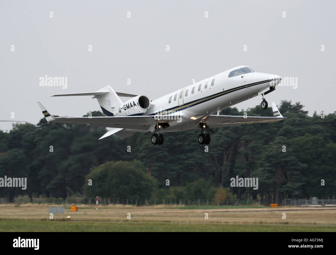 Business aviation. Bombardier Learjet 45 executive jet taking off from Farnborough, UK - Stock Image