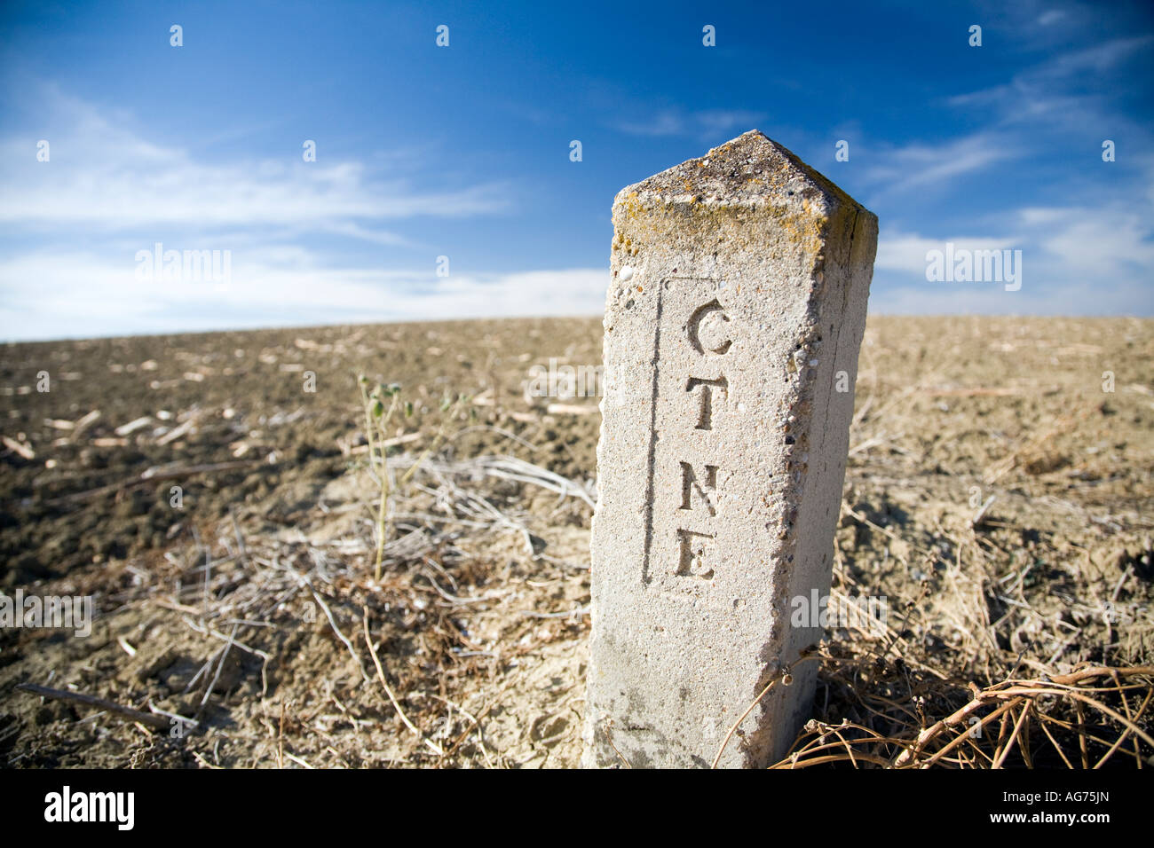 Marker on countryside of Spanish Telefonica corporation network Spain - Stock Image