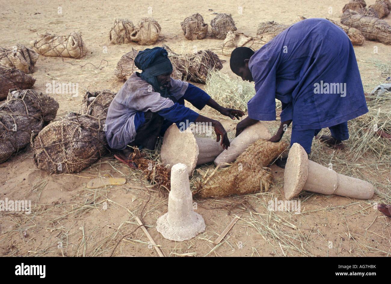 Niger Fachi Mature man and teenage boy of Tuareg tribe loading salt - Stock Image