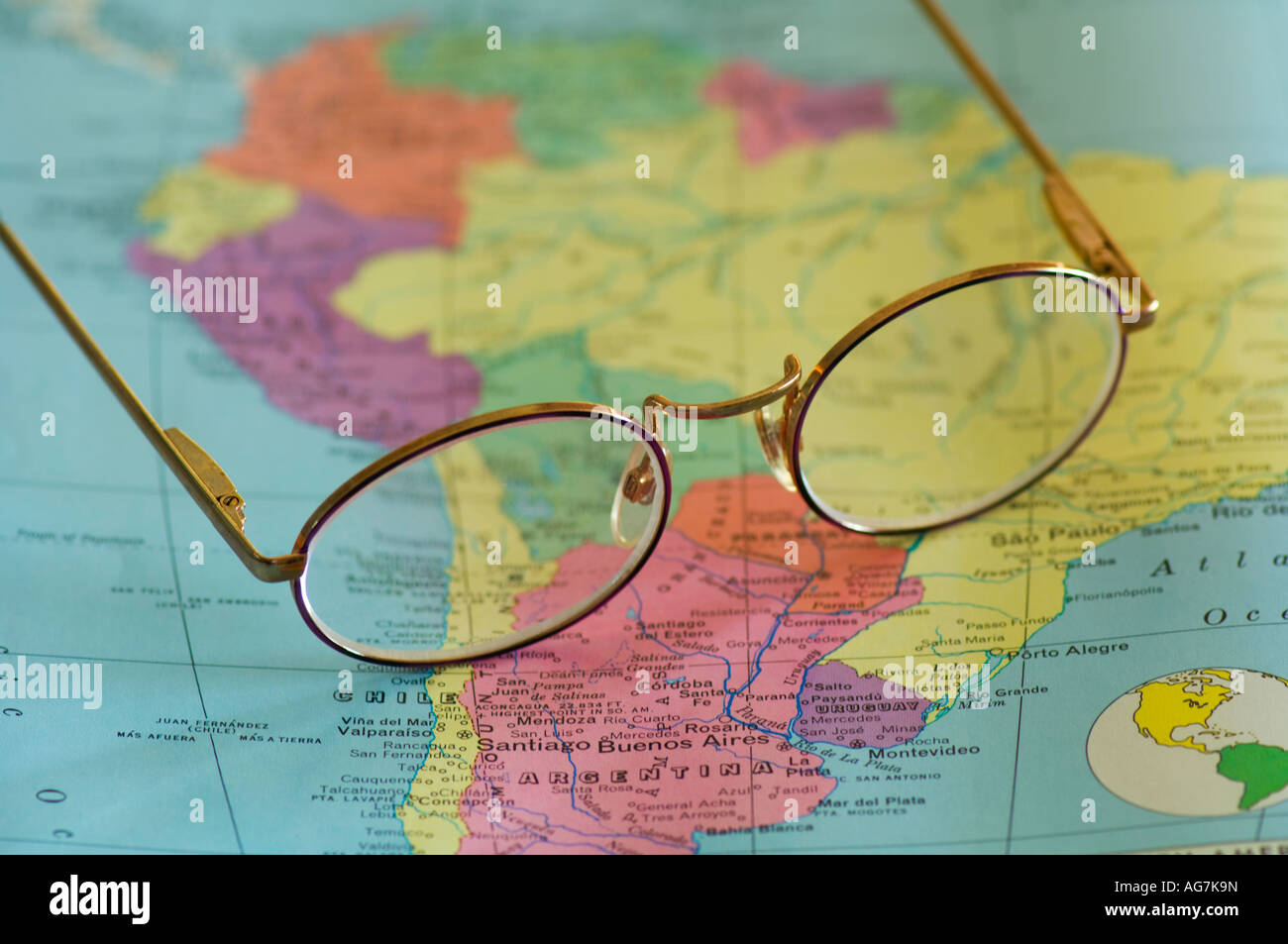 closeup of reading glasses on map of South America - Stock Image