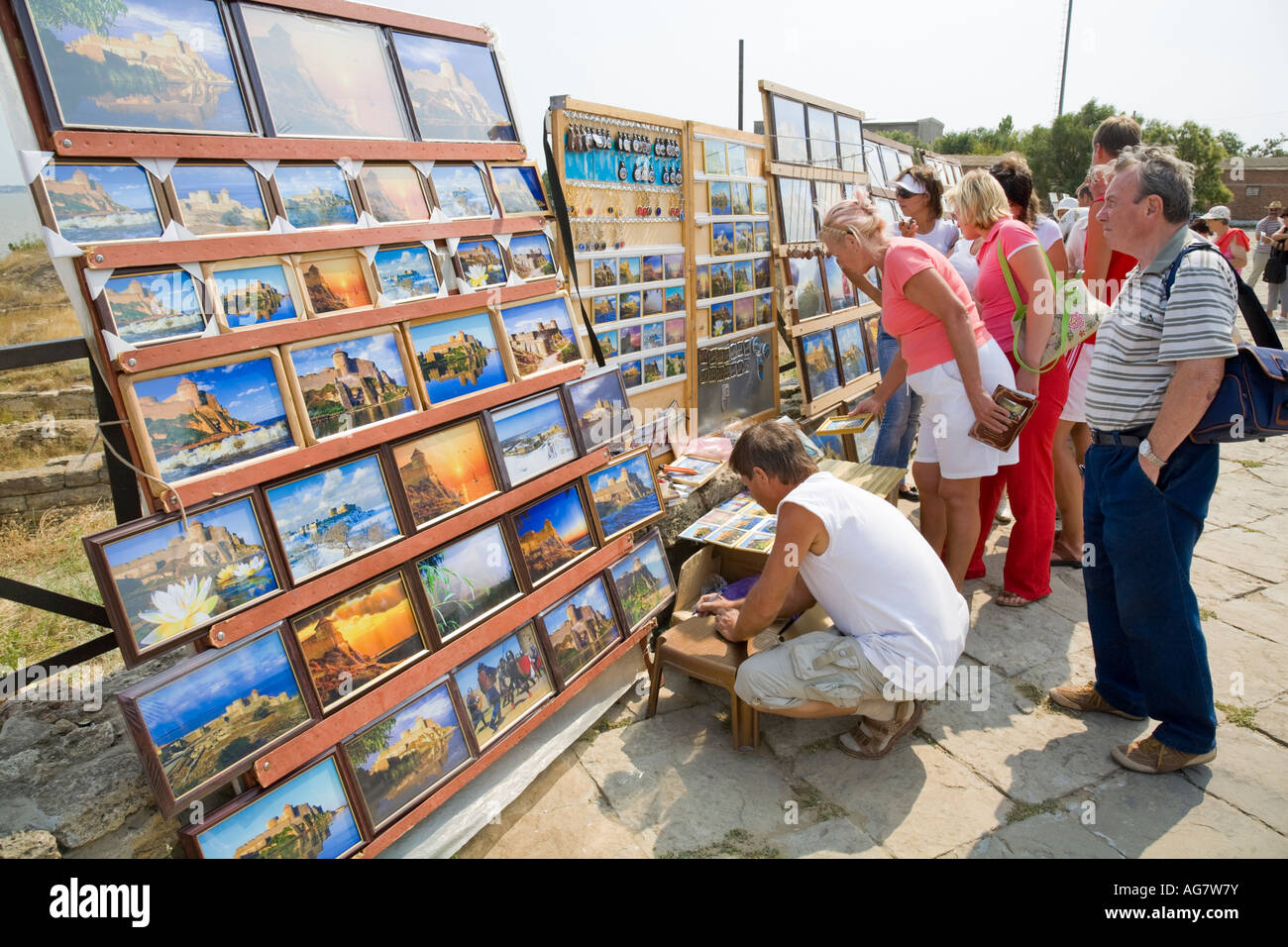 Tourists at a stall which is selling images of the fortress of Akkerman Stock Photo