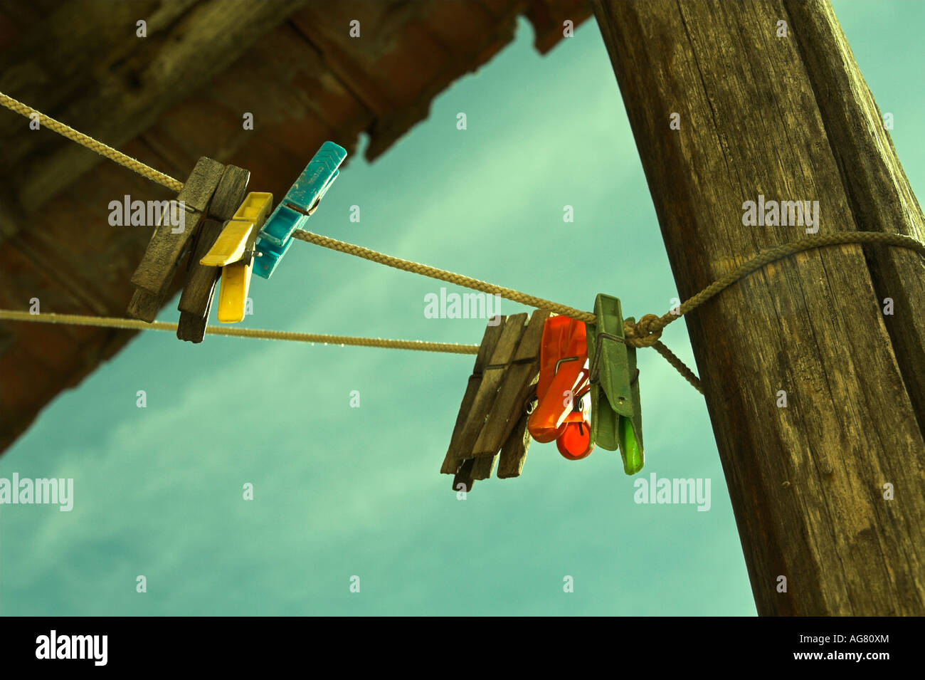 Clothes pegs on washing line - Stock Image